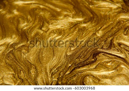 Painted background. Abstract emotional art. Modern design element. Golden liquid acrylic paints #603003968