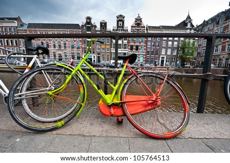 Painted Bicycle on the Embankment of Amsterdam