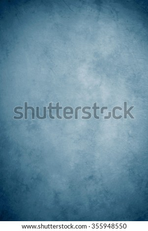 Painted canvas or muslin fabric cloth studio backdrop or background, suitable for use with portraits, products and concepts. Various shades of blue.