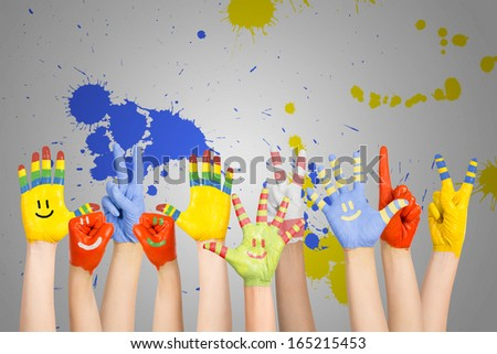 painted children\'s hands in different colors with smilies
