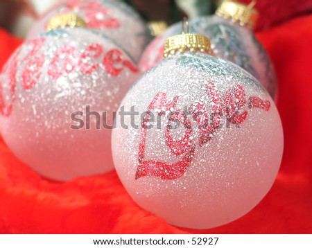 Painted Christmas bulbs. Focus on Love bulb. - stock photo