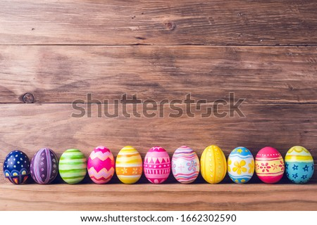 Painted colorful easter eggs on brown wood background. Foto stock ©