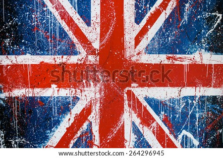 Painted concrete wall with graffiti of British flag Grunge flag of United Kingdom Union Jack