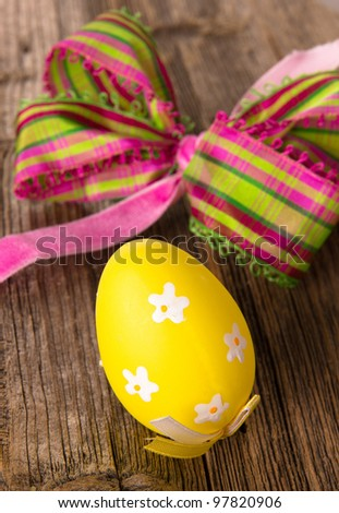 Painted Easter Eggs on wooden background