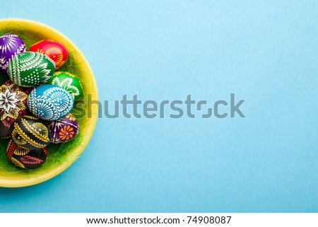 painted Easter eggs on yellow plate