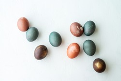 painted eggs on white stone   backround,. Happy easter concept. Natural colorful egg, pastel and natural color.
