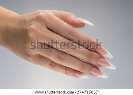 Painted extreme long nails and hands isolated on white background