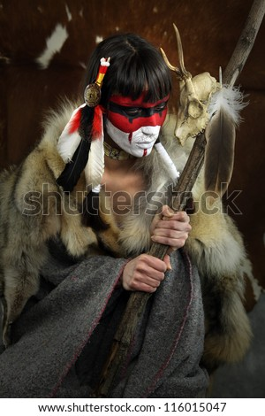 Painted face, native american woman with war mask. Cracked paint ...