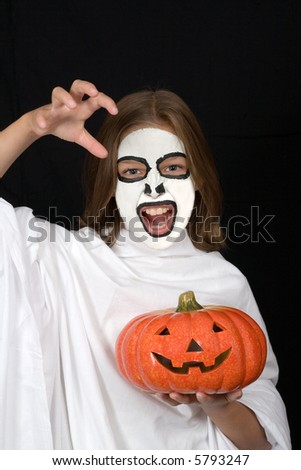painted faces halloween ghost girl with an  halloween pumpkin