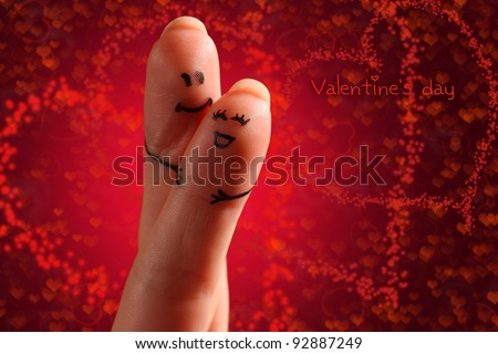 Painted finger smiley on a brightly colored background with layered hearts interacting with each other. Good as Valentine's day  theme.