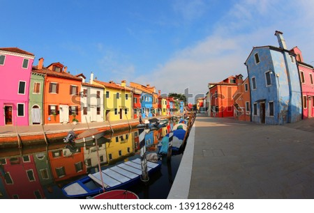 Painted Houses Burano Island near Venice in Italy and more boats with blue sky #1391286248