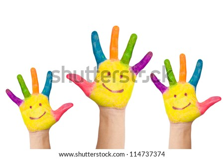 Painted in different colors, with the palms painted smiling faces, a few childs hands raised up. Greeting or voting approval or teamwork. Isolated on white background #114737374