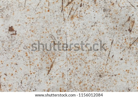 painted in white iron surface with rusty scratches. Rusty background. A rusty old metal plate with cracked white gloss paint. Rusty White Metal Texture