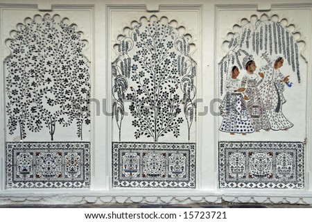 Painted murals of trees and Indian ladies inlaid with small mirrors