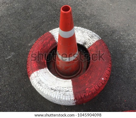 painted old stack tires, white and red color, array together isolated on white for no parking sign or no entrance sign #1045904098