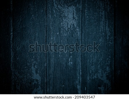 painted old wooden wall.dark blue background