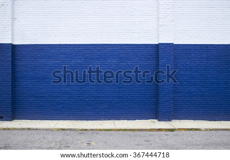 Painted on blue brick wall on the street