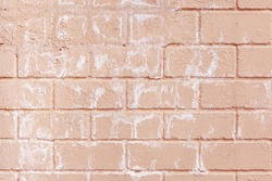 Painted Pink Brick Wall With Salty Spots And Streaks. Pale Pastel Pink Peach Trendy Color Brick Wall Grunge Style Urban Design Wallpaper Background.