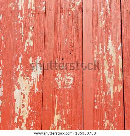 Painted red old wooden wall. rustic background.