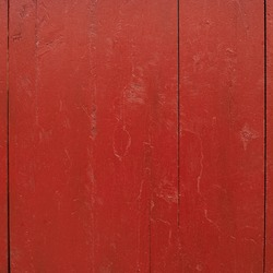 Painted red wooden fence fragment as a background texture