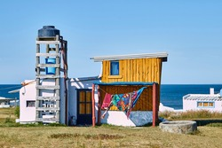 Painted shack with water tank in the dropout village Cabo Polonio in Uruguay, South America