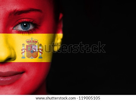 Painted woman face with flag of Spain