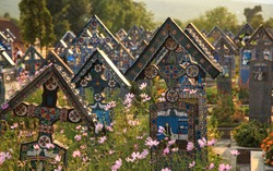 Painted wooden crosses in the beautiful Merry Cemetery, unique and funny monuments Romania