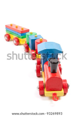 Painted wooden train toy isolated on white