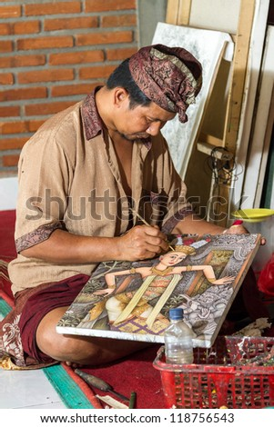 Painter drawing on canvas in gallery, Bali, Indonesia