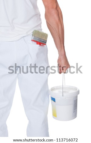 Painter Holding A Paint Roller And Bucket On White Background
