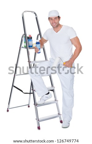 Painter Holding A Paint Roller And Paint Bottle Leaning On Ladder Against White Background