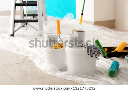 Painter's tools on floor indoors