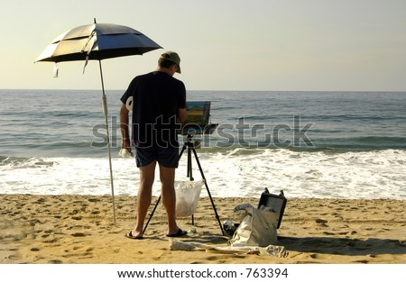 Painter takes advantage of the beach