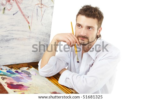 Painter with brush and palette. Isolated over white