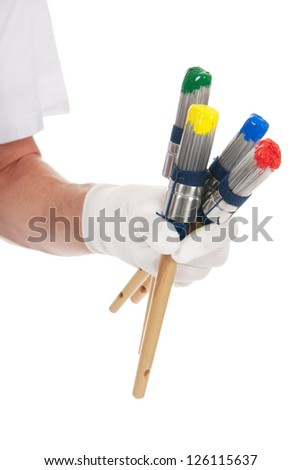 Painter with colorful paint brushes