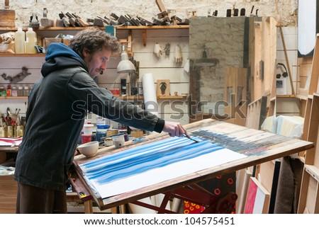 painter working at workshop studio