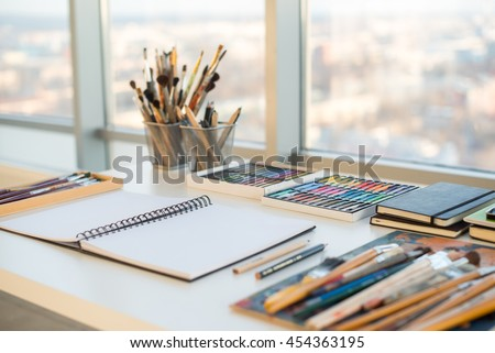 Painter workplace in order side view. Designer desk with drawing equipment. Home studio for artist #454363195