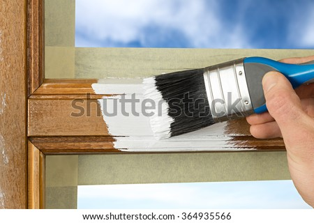 Shutterstock painting a window frame with white color