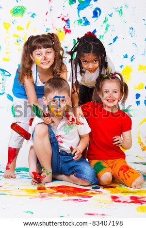 Painting activity keeping four kids busy