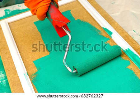 painting carried out by the roller, the master carries out repair #682762327