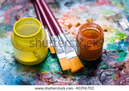 Painting material, brushes, oil pigment, focus on brushes, low deep of field