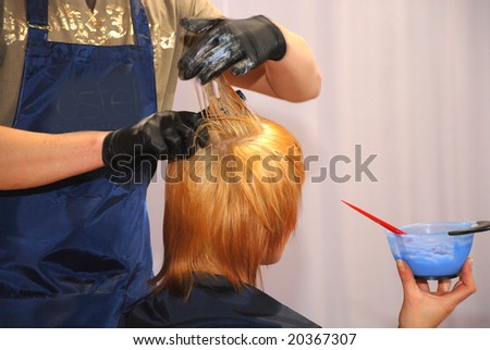 Painting of hair in a beauty salon