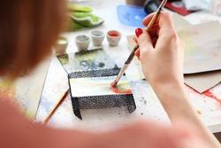 Painting on glass. Laboratory ceramics, painting on ceramic plate.