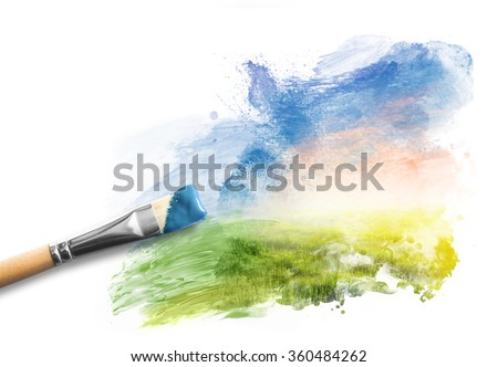 Painting the spring landscape. Brush with blue paint over sky and green field. Concept of creating art, creativity, imagination.