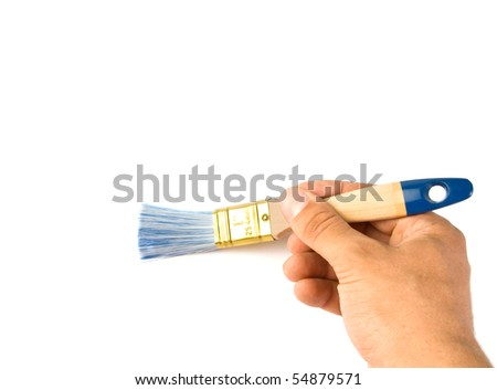 Painting the wall with a paint brush. Isolated - stock photo