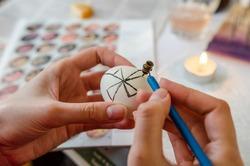 Painting traditional Ukrainian pysanka, Easter eggs