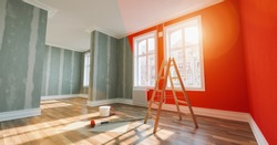 Painting wall red in room before and after restoration or refurbishment