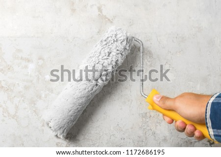 Painting white walls with a roller #1172686195
