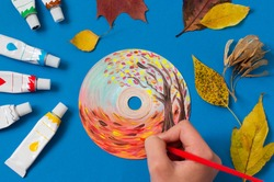 Painting with acrylics paints on CD. Seasons. Autumn landscape. Creative art project
