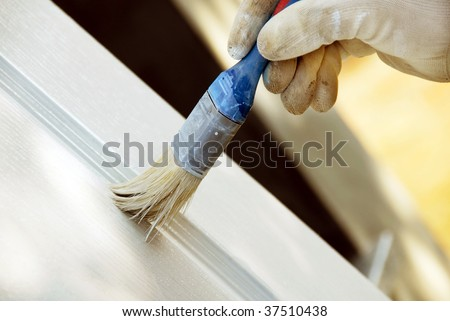 painting wooden door in white color by blue brush
